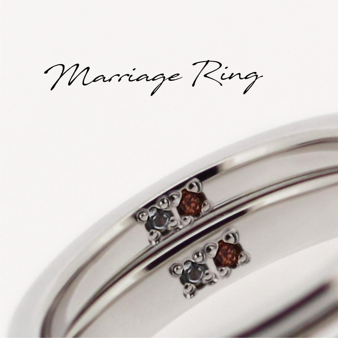 ペアの結婚指輪の内側に、誕生石を2ピースずつ留めている。